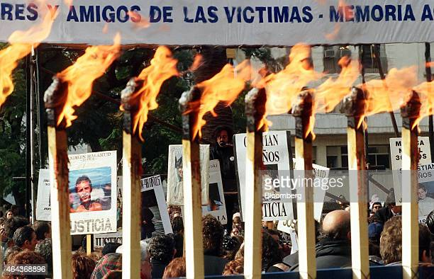 Demonstrators assemble on the third anniversary of the carbombing at the Asociacion Mutual Israelita Argentina Jewish community center in Buenos...