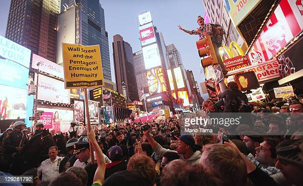 Demonstrators associated with the 'Occupy Wall Street' movement protest in Times Square on October 15, 2011 in New York City. Thousands of people are...
