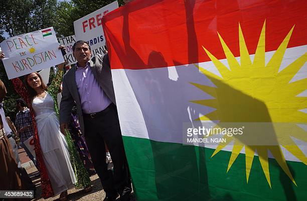 Demonstrators at a rally supporting Kurdistan hold placards protesting against the Islamic State of Iraq and Syria in front of the White House on...
