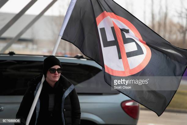 Demonstrators at Michigan State University protest a speech by white nationalist Richard Spencer who popularized the term 'altright' on March 5 2018...