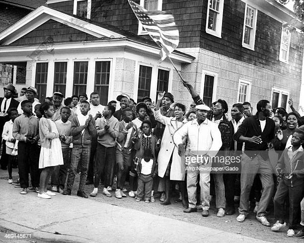 Demonstrators at the Cambridge protests waving an American flag and calling for desegregation Cambridge Maryland July 20 1963