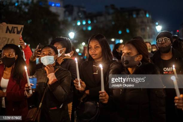 Demonstrators at the candlelight procession to remember victims of SARS and those assaulted by Nigeria Police gather at Trafalgar Square on October...
