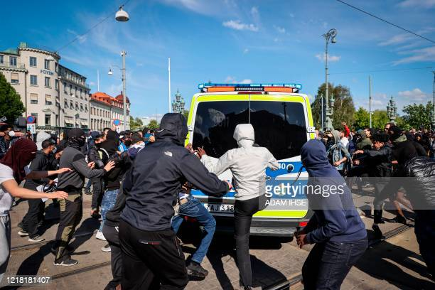 Demonstrators attack a police car during a antiracism demonstration on June 7 2020 in Gothenburg Sweden in solidarity with protests raging across the...