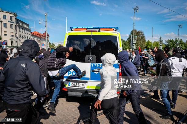 Demonstrators attack a police car during a anti-racism demonstration on June 7, 2020 in Gothenburg, Sweden, in solidarity with protests raging across...