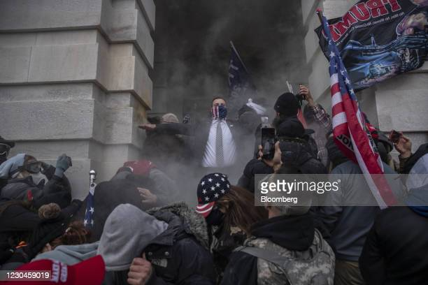 Demonstrators attempt to breach the U.S. Capitol after they earlier stormed the building in Washington, DC, U.S., on Wednesday, Jan. 6, 2021. The...