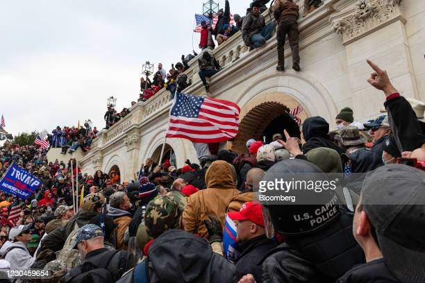 Demonstrators attempt to enter the U.S. Capitol building during a protest in Washington, D.C., U.S., on Wednesday, Jan. 6, 2021. The U.S. Capitol was...