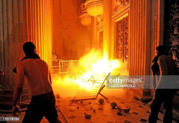 Demonstrators attempt to take the Tiradentes Palace Rio de Janeiro's Legislative Assembly building during a protest in Rio de Janeiro on June 17 2013...