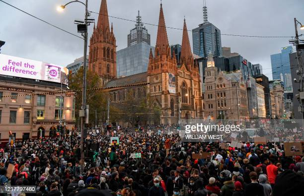 Demonstrators attend a Black Lives Matter protest to express solidarity with US protestors in Melbourne on June 6, 2020 and demand an end to frequent...