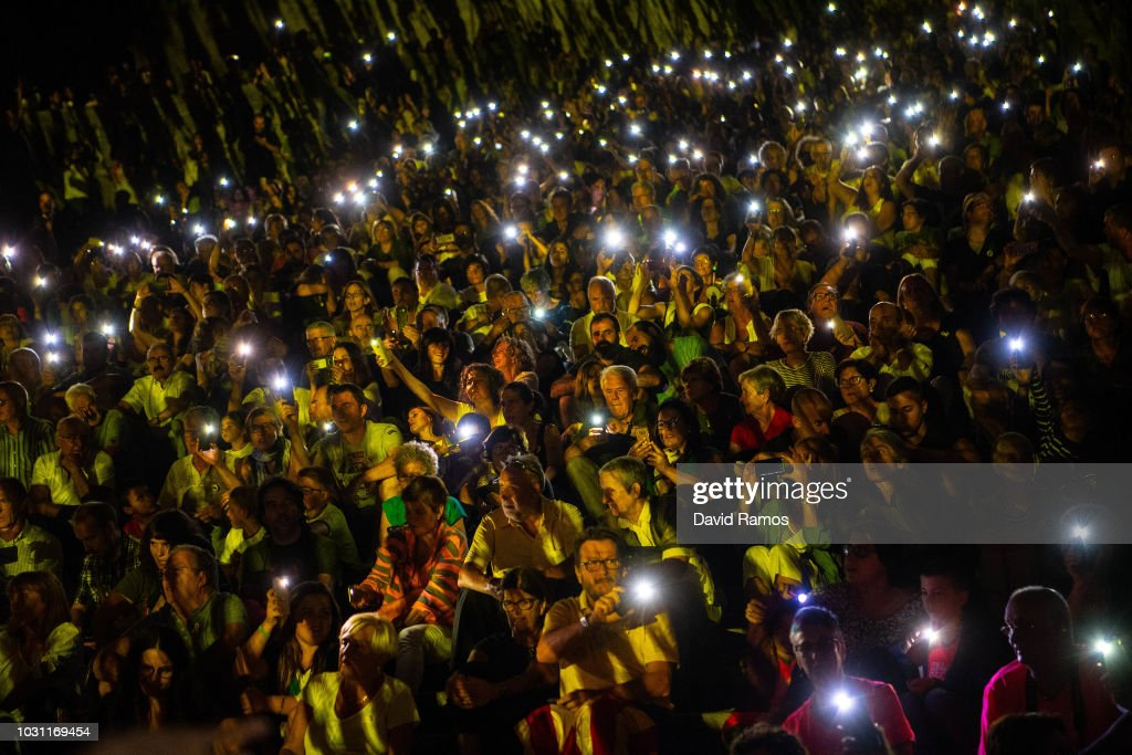 Demonstrators attend a concert ahead of a Pro-independencce demonstration on September 10, 2018 in Girona, Spain. The Spanish northeastern autonomous region celebrates its National Day on September 11, ahead of the 1st anniversary of the secession referendum held last October 1, which was approved by the Catalan Government and banned by the Spanish government.