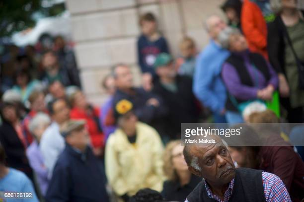Demonstrators attend a counter protest rally organized by the NAACP in response of a planned Klu Klux Klan rally to be held nearby May 20 2017 in...