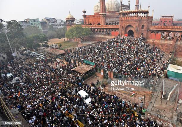 Demonstrators attend a protest against a new citizenship law, after Friday prayers at Jama Masjid at the old Delhi Area on December 20, 2019 in New...