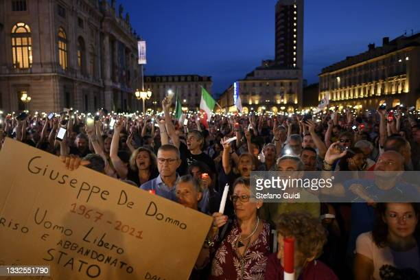 Demonstrators attend a protests against Italy's mandatory Green Pass Covid-19 certificate on August 5, 2021 in Turin, Italy. Italy will impose...