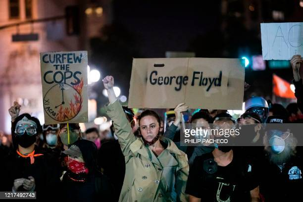"""Demonstrators attend a """"Sit Out the Curfew"""" protest against the death of George Floyd who died on May 25 in Minneapolis whilst in police custody,..."""