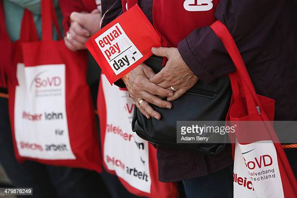 Demonstrators attend the 'Equal Pay Day' demonstration on March 21 2014 in Berlin Germany The annual event recognizes the wage gap between the sexes...
