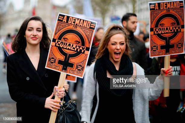 """Demonstrators attend the """"March4Women"""" during the International Women's Day in London on March 8, 2020. - Many feminist groups held online campaigns..."""