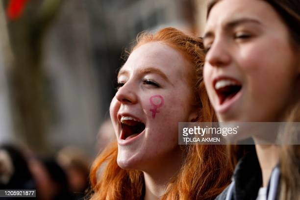"Demonstrators attend the ""March4Women"" during the International Women's Day in London on March 8, 2020. - Many feminist groups held online campaigns..."