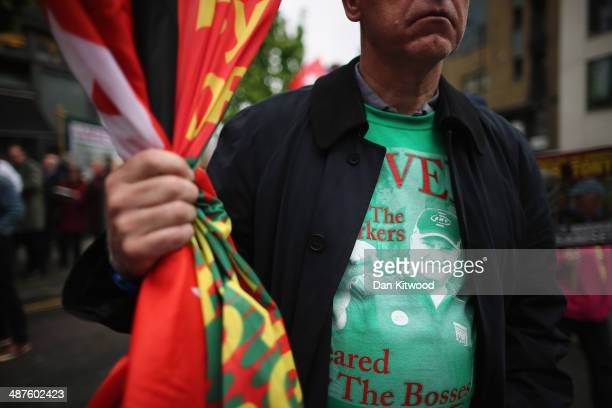 Demonstrators begin the annual May Day March to Trafalgar Square on May 1 2013 in London England Thousands attended the traditional May Day Rally...