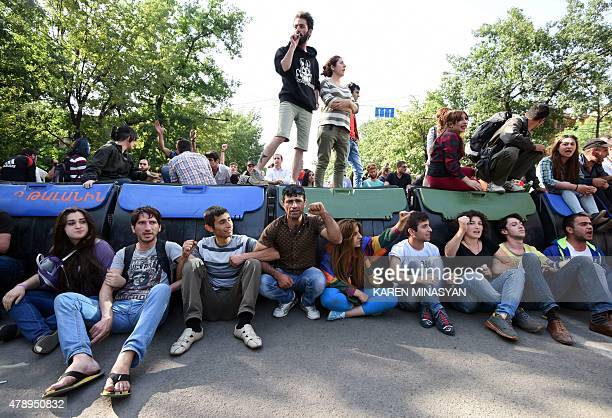 Demonstrators block a street during a protest against an increase of electricity prices in Yerevan on June 29 2015 AFP PHOTO / KAREN MINASYAN
