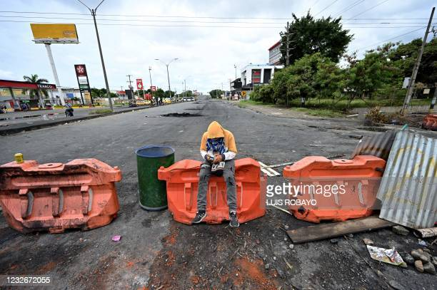 Demonstrators block a street with a barricade to protest against a tax reform bill launched by President Ivan Duque, in Cali, Colombia, on May 3,...