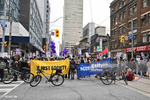 Demonstrators block Bay Street during a rally against racism and support for migrant workers rights in downtown Toronto Ontario Canada on June 16...
