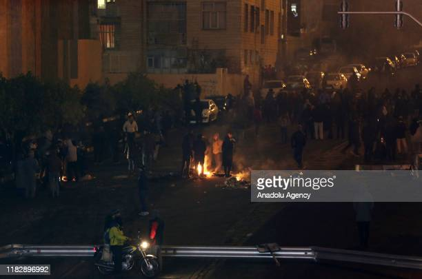 Demonstrators block main streets of Tehran during a demonstration against a government decision to hike petrol prices, in Tehran, Iran on November...