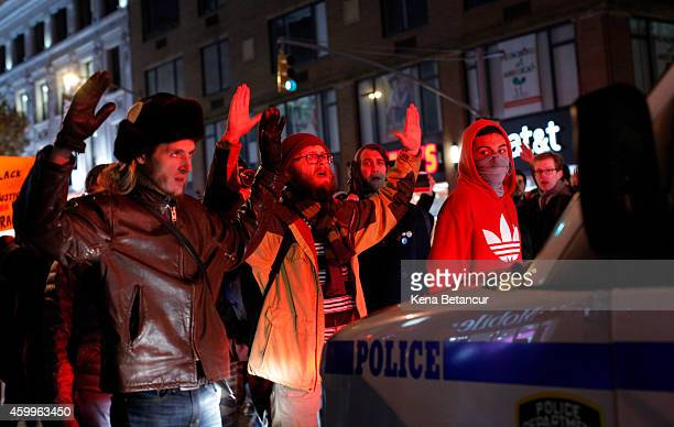 Demonstrators block police on the street following yesterday's decision by a Staten Island grand jury not to indict a police officer who used a...