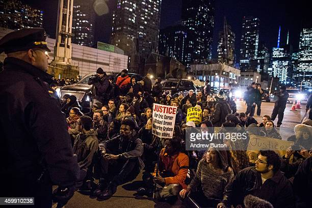 Demonstrators block the entrance to the Lincoln Tunnel following a Staten Island New York grand jury's decision not to indict a police officer...