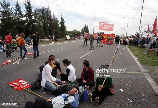 Demonstrators block the PanAmerican Highway in Buenos Aires Argentina on Thursday April 10 2014 Argentina's biggest unions paralyzed metro train and...