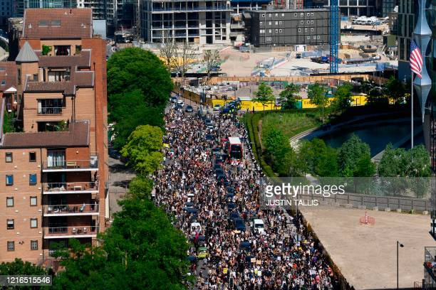 Demonstrators block the road as they gather outside the US Embassy in London on May 31, 2020 to protest the death of George Floyd, an unarmed black...