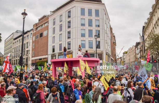 Demonstrators block the streets with a giant table, symbolizing their demand for the government to 'come to the table' during the protest in Covent...