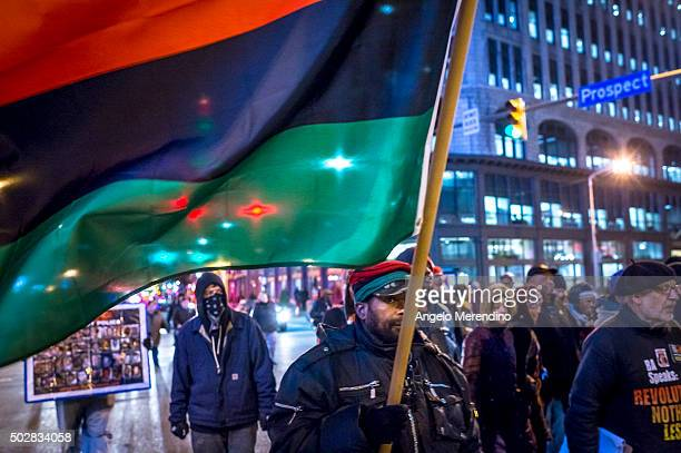 Demonstrators block traffic as they march through the intersection of Prospect and E 9th St on December 29 2015 in Cleveland Ohio Protestors took to...