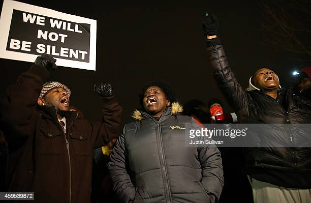 Demonstrators block traffic as they protest in front of the Ferguson police department on November 24 2014 in Ferguson Missouri A St Louis County...