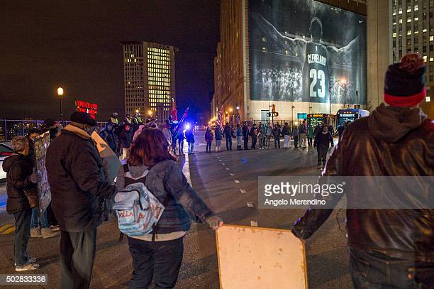 Demonstrators block traffic at the corner of Ontario Street and Huron Road near Quicken Loans Arena on December 29 2015 in Cleveland Ohio Protestors...