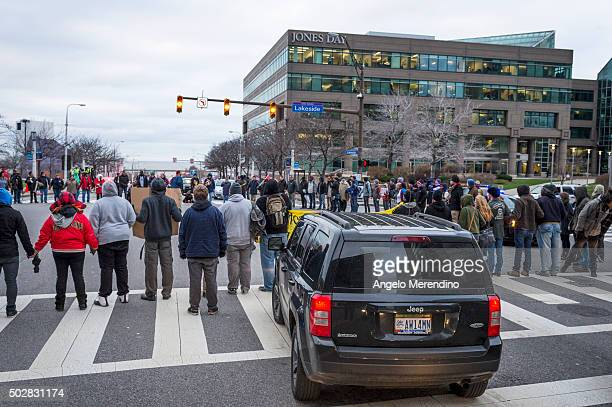 Demonstrators block traffic at the intersection of Lakeside and E9th St on December 29 2015 in Cleveland Ohio Protestors took to the street the day...