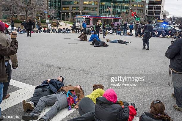 Demonstrators block traffic by laying down at the intersection of Lakeside and E 9th St on December 29 2015 in Cleveland Ohio Protestors took to the...