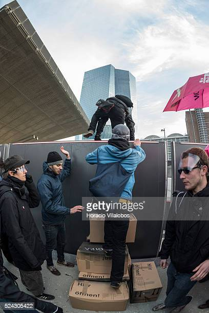 Demonstrators brake into the premisses of the new EBC building during a Blockupy rally to protest European Central Bank policies in Frankfurt Germany...