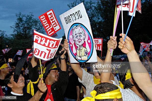 Demonstrators brandish a cartoon showing Prem Tinsulanonda, a former Prime Minister and currently the president of Privy Council. A few thousand...