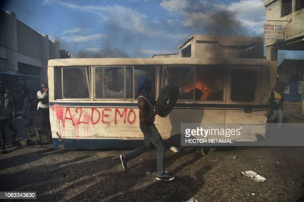 TOPSHOT Demonstrators burn a barricade during a protest demanding accountability from politicians for allegedly squandering billions of dollars in...