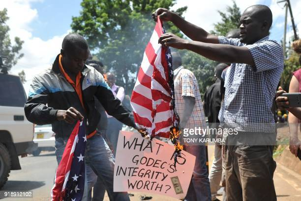Demonstrators burn a US flag outside the US embassy in Kenyan capital Nairobi during a demonstration calling for the withdrawal of US Ambassador to...