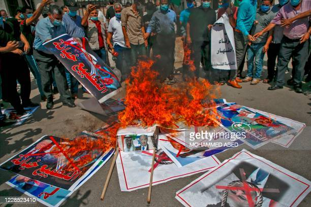Demonstrators burn pictures depicting Abu Dhabi Crown Prince Sheikh Mohammed bin Zayed al-Nahyan, Bahrain's King Hamad bin Isa al-Khalifa, US...