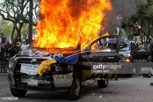 Demonstrators burn police vehicles during a protest following the death of a young man while in police custody, after he had been arrested allegedly...