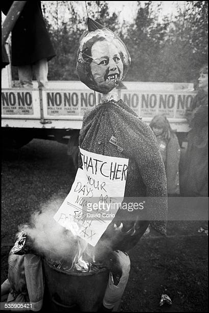 Demonstrators burn Poll Tax forms and a Margaret Thatcher effigy during a Poll Tax demonstration on Market Road London N7 UK 5th November 1989