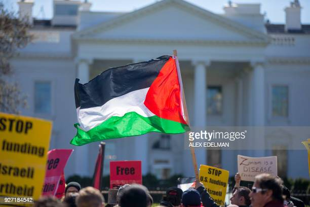 Demonstrators call for an independent Palestinian state during a protest held outside the White House in Washington DC on March 4 2018 / AFP PHOTO /...
