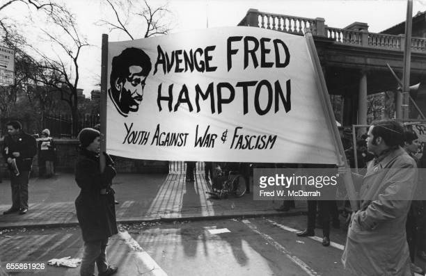 Demonstrators carry a banner that reads 'Avenge Fred Hampton' during a protest at Union Square New York New York December 18 1969 Hampton was a Black...