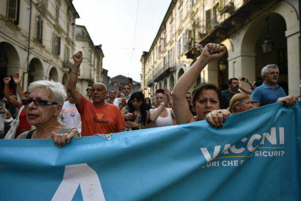 ITA: No Vax and Free Vax Demonstrators Protest At Introduction Of Italy's Green Pass