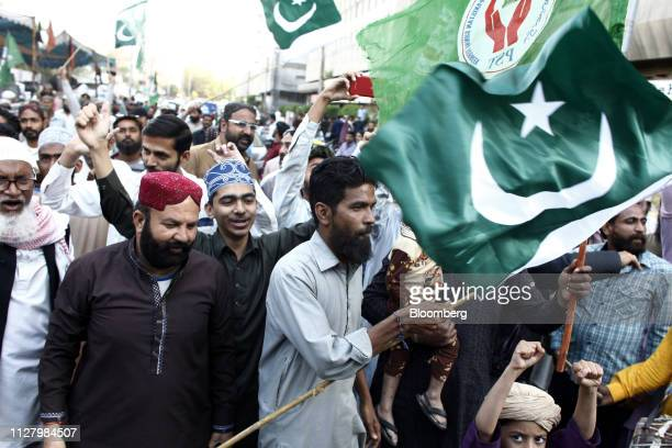 Demonstrators carry flags and shout slogans during an antiIndia protest in Karachi Pakistan on Wednesday Feb 27 2019 Pakistani fighter jets have shot...