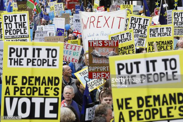 Demonstrators carry placards and European Union flags as they march on Piccadilly during the antiBrexit People's Vote rally in London UK on Saturday...
