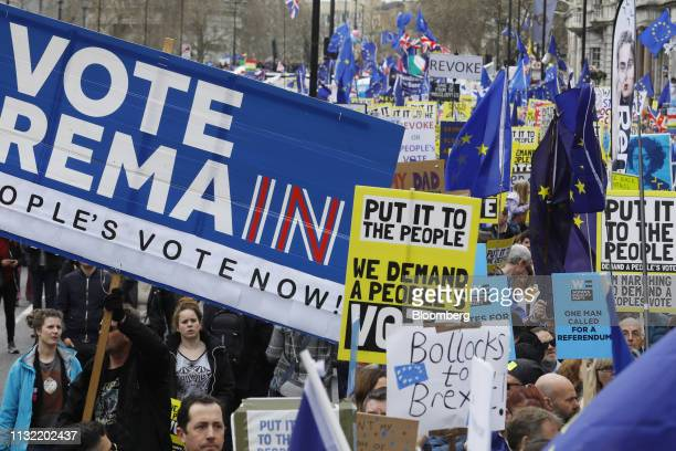 Demonstrators carry placards and European Union flags as they march around Piccadilly during the antiBrexit People's Vote rally in London UK on...