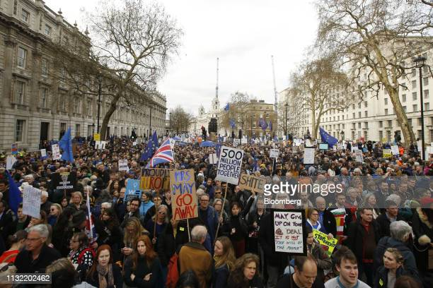 Demonstrators carry placards and European Union flags as they march along Whitehall during the antiBrexit People's Vote rally in London UK on...