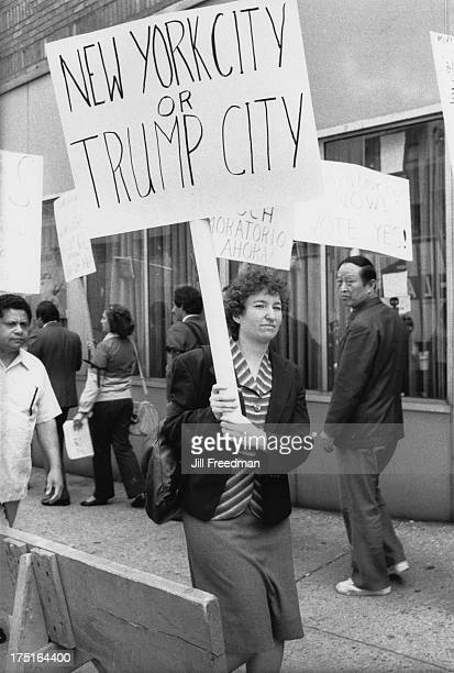 Demonstrators carry placards in a Midtown Manhattan street New York City 1972